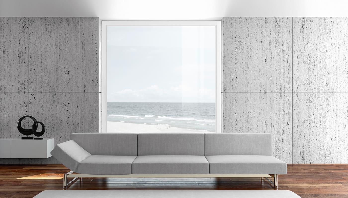 Salotto_arredato_con_finestra_legno_naturale_finnova